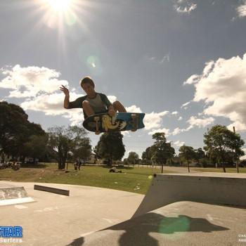 surfing-grab-rail-air-dom-surfing-skateboard